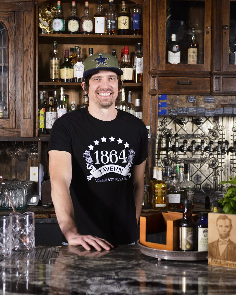 Dylan Evans, Co-Owner of 1864 Tavern in Reno behind the bar