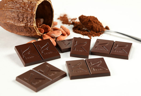 multiple bars of LiveKAYA chocolate with cocoa powder and cacao